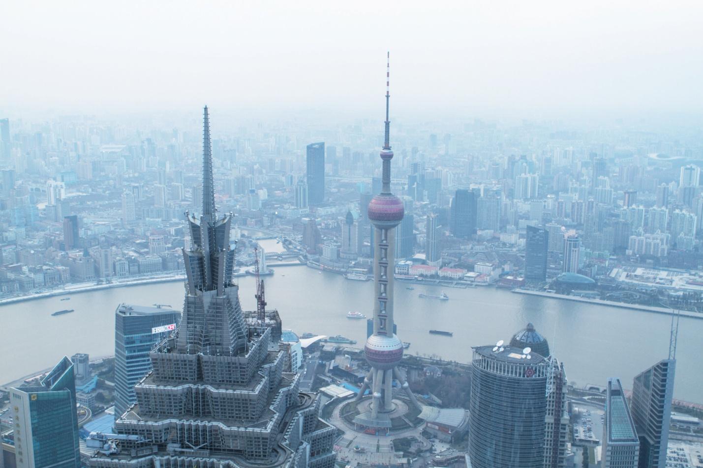 Г.Шанхай с населением более 24 млн.человек